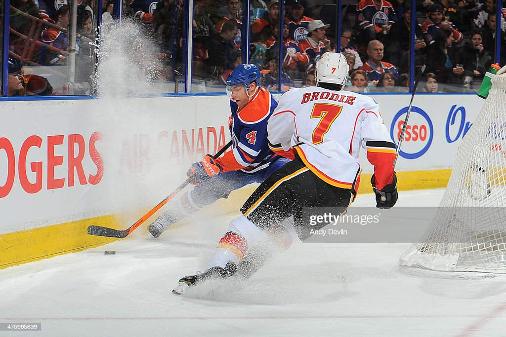 <a gi-track='captionPersonalityLinkClicked' href=/galleries/search?phrase=Taylor+Hall&family=editorial&specificpeople=2808377 ng-click='$event.stopPropagation()'>Taylor Hall</a> #4 of the Edmonton Oilers battles for the puck against T.J. Brodie #7 of the Calgary Flames on March 1, 2014 at Rexall Place in Edmonton, Alberta, Canada.