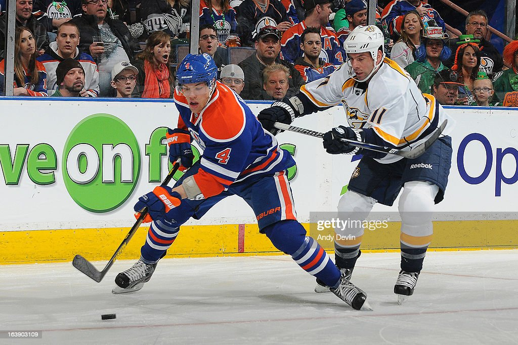 <a gi-track='captionPersonalityLinkClicked' href=/galleries/search?phrase=Taylor+Hall&family=editorial&specificpeople=2808377 ng-click='$event.stopPropagation()'>Taylor Hall</a> #4 of the Edmonton Oilers being pursued by <a gi-track='captionPersonalityLinkClicked' href=/galleries/search?phrase=David+Legwand&family=editorial&specificpeople=202553 ng-click='$event.stopPropagation()'>David Legwand</a> #11 of the Nashville Predators on March 17, 2013 at Rexall Place in Edmonton, Alberta, Canada.