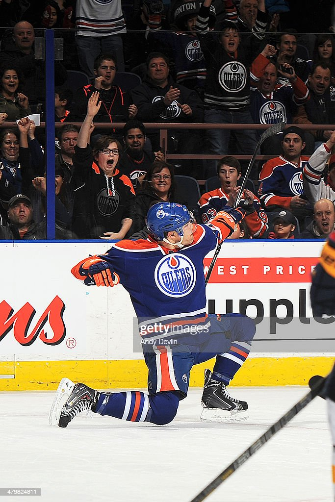 Taylor Hall #4 of the Edmonton Oilers celebrates after scoring a goal against the Buffalo Sabres on March 20, 2014 at Rexall Place in Edmonton, Alberta, Canada.