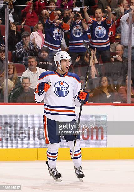 Taylor Hall of the Edmonton Oilers celebrates after scoring a third period goal against the Phoenix Coyotes during the NHL game at Jobingcom Arena on...