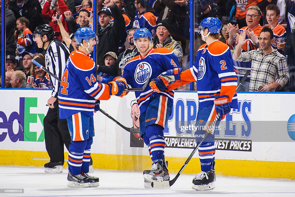 <a gi-track='captionPersonalityLinkClicked' href=/galleries/search?phrase=Taylor+Hall&family=editorial&specificpeople=2808377 ng-click='$event.stopPropagation()'>Taylor Hall</a> #4 of the Edmonton Oilers celebrates after scoring his team's seventh goal against the Columbus Blue Jackets during an NHL game at Rexall Place on November 19, 2013 in Edmonton, Alberta, Canada. The Oilers defeated the Blue Jackets 7-0.