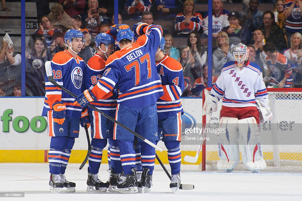 <a gi-track='captionPersonalityLinkClicked' href=/galleries/search?phrase=Taylor+Hall&family=editorial&specificpeople=2808377 ng-click='$event.stopPropagation()'>Taylor Hall</a> #4 of the Edmonton Oilers celebrates his goal against Martin Biron #43 of the New York Rangers along with his teammates <a gi-track='captionPersonalityLinkClicked' href=/galleries/search?phrase=Justin+Schultz&family=editorial&specificpeople=5370958 ng-click='$event.stopPropagation()'>Justin Schultz</a> #19, Anton Belov #77 and <a gi-track='captionPersonalityLinkClicked' href=/galleries/search?phrase=Ales+Hemsky&family=editorial&specificpeople=202828 ng-click='$event.stopPropagation()'>Ales Hemsky</a> #83 during a preseason NHL game at Rexall Place on September 24, 2013 in Edmonton, Alberta, Canada.