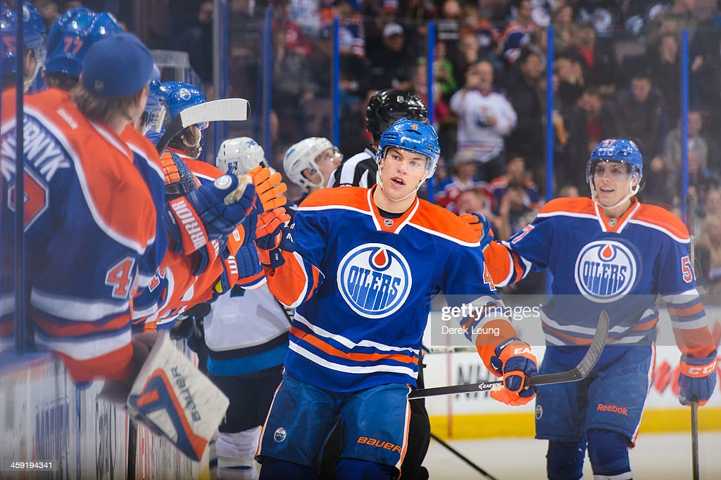 <a gi-track='captionPersonalityLinkClicked' href=/galleries/search?phrase=Taylor+Hall&family=editorial&specificpeople=2808377 ng-click='$event.stopPropagation()'>Taylor Hall</a> #4 of the Edmonton Oilers celebrates his third period goal against the Winnipeg Jets during an NHL game at Rexall Place on December 23, 2013 in Edmonton, Alberta, Canada. The Oilers defeated the Jets 6-2.