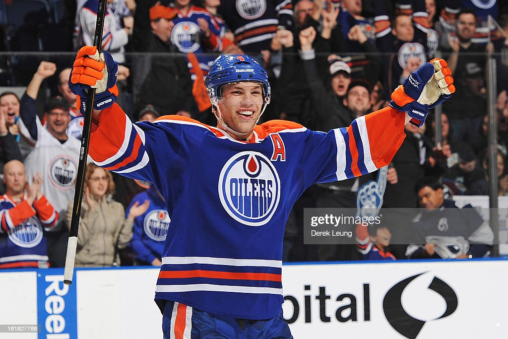 <a gi-track='captionPersonalityLinkClicked' href=/galleries/search?phrase=Taylor+Hall&family=editorial&specificpeople=2808377 ng-click='$event.stopPropagation()'>Taylor Hall</a> #4 of the Edmonton Oilers celebrates the empty net goal by his teammate Jordan Eberle #14 (not pictured) against the Colorado Avalanche during the NHL game at Rexall Place on February 16, 2013 in Edmonton, Alberta, Canada. Oilers won 6-4.