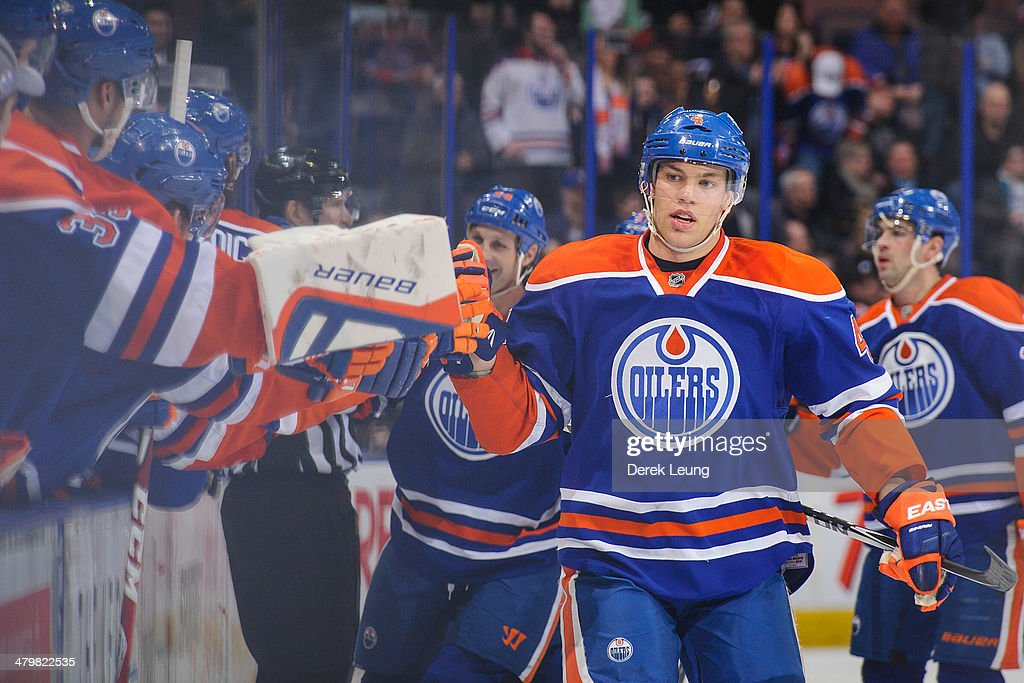 Taylor Hall #4 of the Edmonton Oilers celebrates with the bench after scoring against the Buffalo Sabres during an NHL game at Rexall Place on March 20, 2014 in Edmonton, Alberta, Canada.