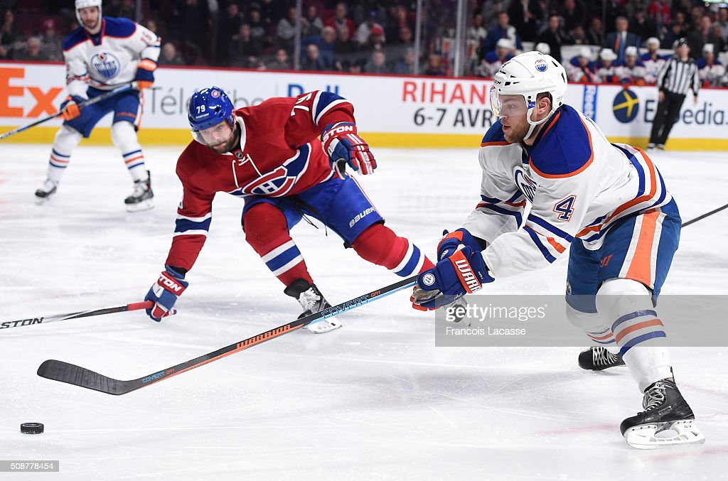 <a gi-track='captionPersonalityLinkClicked' href=/galleries/search?phrase=Taylor+Hall&family=editorial&specificpeople=2808377 ng-click='$event.stopPropagation()'>Taylor Hall</a> #4 of the Edmonton Oilers controls the puck while being challenged by <a gi-track='captionPersonalityLinkClicked' href=/galleries/search?phrase=Andrei+Markov&family=editorial&specificpeople=204528 ng-click='$event.stopPropagation()'>Andrei Markov</a> #79 of the Montreal Canadiens in the NHL game at the Bell Centre on February 6, 2016 in Montreal, Quebec, Canada.