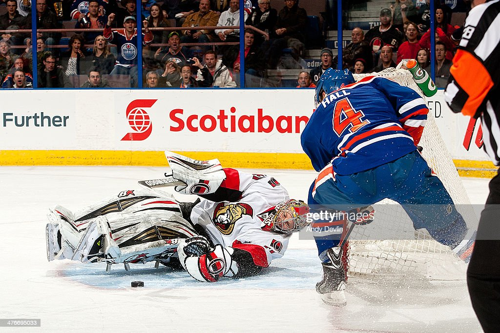Taylor Hall of the Edmonton Oilers has his shot stopped by goalie Craig Anderson of the Ottawa Senators on March 4 2014 at Rexall Place in Edmonton...
