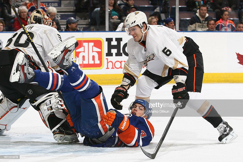 <a gi-track='captionPersonalityLinkClicked' href=/galleries/search?phrase=Taylor+Hall&family=editorial&specificpeople=2808377 ng-click='$event.stopPropagation()'>Taylor Hall</a> #4 of the Edmonton Oilers is knocked down in front of the net by <a gi-track='captionPersonalityLinkClicked' href=/galleries/search?phrase=Ben+Lovejoy&family=editorial&specificpeople=4509565 ng-click='$event.stopPropagation()'>Ben Lovejoy</a> #6 of the Anaheim Ducks on April 22, 2013 at Rexall Place in Edmonton, Alberta, Canada.