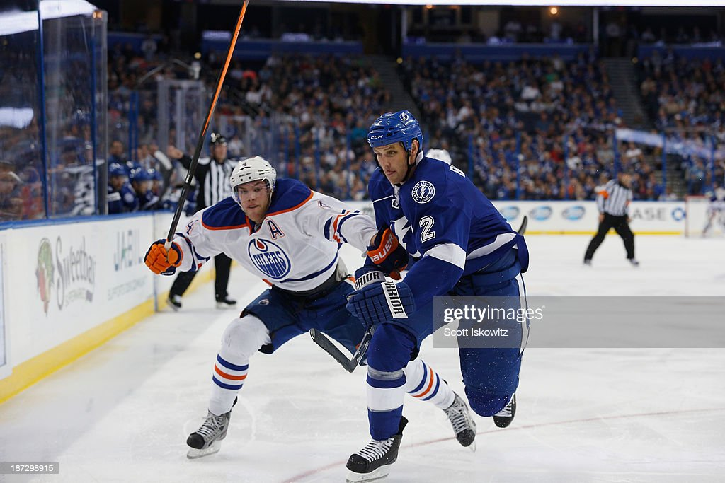 Taylor Hall #4 of the Edmonton Oilers races to the puck against <a gi-track='captionPersonalityLinkClicked' href=/galleries/search?phrase=Eric+Brewer&family=editorial&specificpeople=202144 ng-click='$event.stopPropagation()'>Eric Brewer</a> #2 of the Tampa Bay Lightning during the third period at Tampa Bay Times Forum on November 7, 2013 in Tampa, Florida.