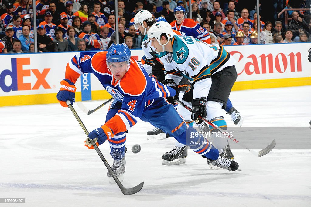 <a gi-track='captionPersonalityLinkClicked' href=/galleries/search?phrase=Taylor+Hall&family=editorial&specificpeople=2808377 ng-click='$event.stopPropagation()'>Taylor Hall</a> #4 of the Edmonton Oilers skates for the puck during a game against the San Jose Sharks at Rexall Place on January 22, 2013 in Edmonton, Alberta, Canada.