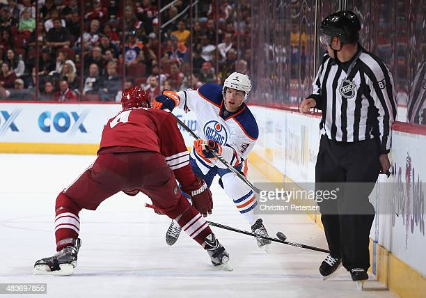Taylor Hall of the Edmonton Oilers skates with the puck during the NHL game against the Phoenix Coyotes at Jobingcom Arena on April 4 2014 in...