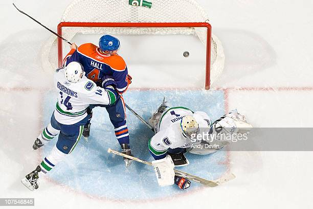 Taylor Hall of the Edmonton Oilers watches the puck go past Roberto Luongo of the Vancouver Canucks for a third period goal at Rexall Place on...