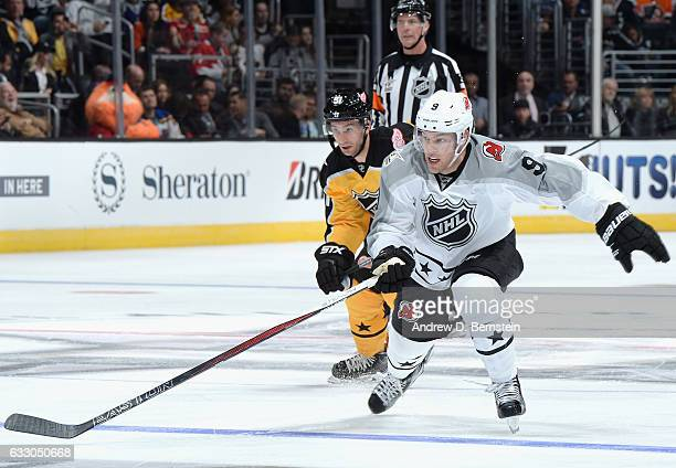 Taylor Hall of the New Jersey Devils and Frans Nielsen of the Detroit Red Wings pursue the play during the Metropolitan Division and Atlantic...