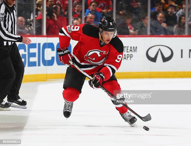 Taylor Hall of the New Jersey Devils plays the puck against the Columbus Blue Jackets during the game at Prudential Center on March 19 2017 in Newark...