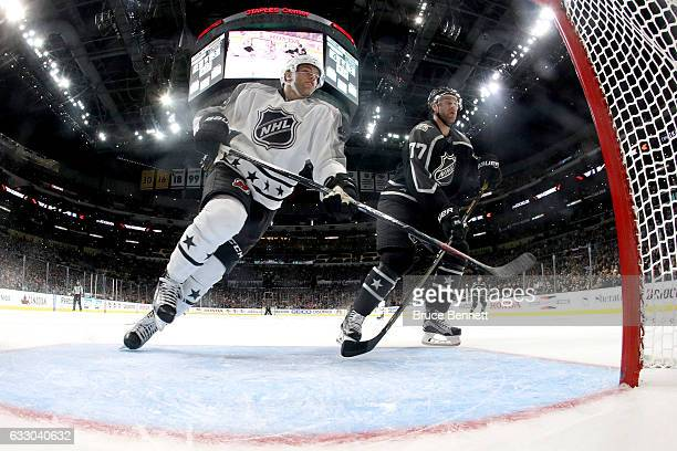 Taylor Hall of the New Jersey Devils skates against Jeff Carter of the Los Angeles Kings during the 2017 Honda NHL AllStar Tournament Final between...