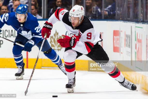 Taylor Hall of the New Jersey Devils skates with the puck against the Toronto Maple Leafs during the third period at the Air Canada Centre on...