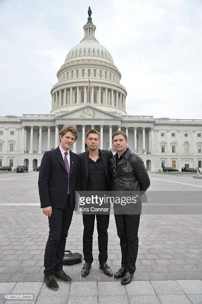 Taylor Hanson Isaac Hanson and Zac Hanson pose for a photo between meetings outside the US Capitol during the Grammy's on the hill lobbying day after...