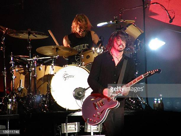 Taylor Hawkins and Dave Grohl of The Foo Fighters perform on stage at Milton Keynes Bowl on July 2nd 2011 in Milton Keynes United Kingdom