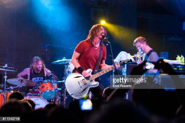 Taylor Hawkins Dave Grohl and Nate Mendel of Foo Fighters performing at Stubb's at the opening of their documentary 'Foo Fighters Back and Forth' at...