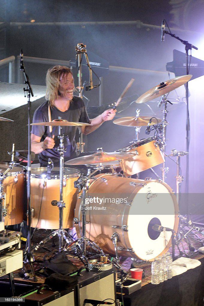Taylor Hawkins performs with the Sound City Players on 'Jimmy Kimmel Live' on March 5, 2013 in Hollywood, California.