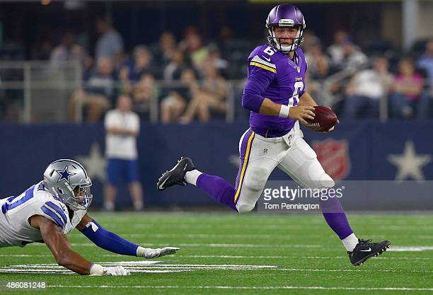 Taylor Heinicke of the Minnesota Vikings scrambles with the ball against Damien Wilson of the Dallas Cowboys during a preseason game on August 29...