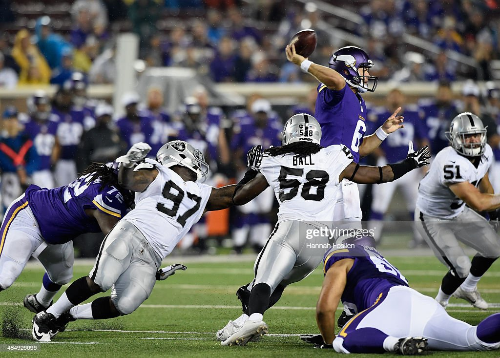 <a gi-track='captionPersonalityLinkClicked' href=/galleries/search?phrase=Taylor+Heinicke&family=editorial&specificpeople=9754186 ng-click='$event.stopPropagation()'>Taylor Heinicke</a> #6 of the Minnesota Vikings throws the ball under pressure form Mario Jr. Edwards #97, <a gi-track='captionPersonalityLinkClicked' href=/galleries/search?phrase=Neiron+Ball&family=editorial&specificpeople=7172670 ng-click='$event.stopPropagation()'>Neiron Ball</a> #58 and <a gi-track='captionPersonalityLinkClicked' href=/galleries/search?phrase=Ben+Heeney&family=editorial&specificpeople=9689082 ng-click='$event.stopPropagation()'>Ben Heeney</a> #51 of the Oakland Raiders during the third quarter of the preseason game on August 22, 2015 at TCF Bank Stadium in Minneapolis, Minnesota. The Vikings defeated the Raiders 20-12.