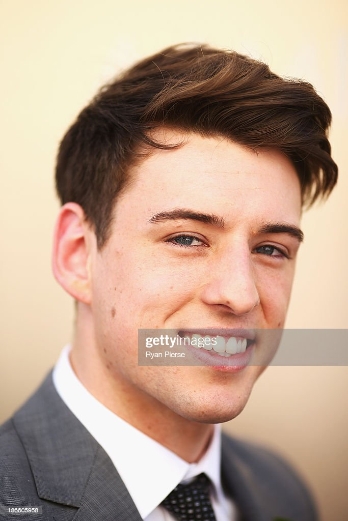 Taylor Henderson arrives on Victoria Derby Day at Flemington Racecourse on November 2, 2013 in Melbourne, Australia.