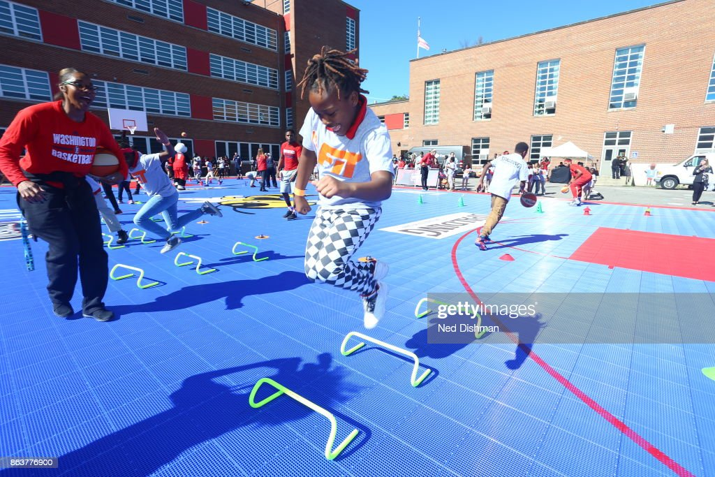 Taylor Hill of the Washington Mystics participates in a clinic at Hendley Elementary school during a court dedication and WNBA Fit Clinic on October 17, 2017 at Hendley Elementary school in Washington, DC.