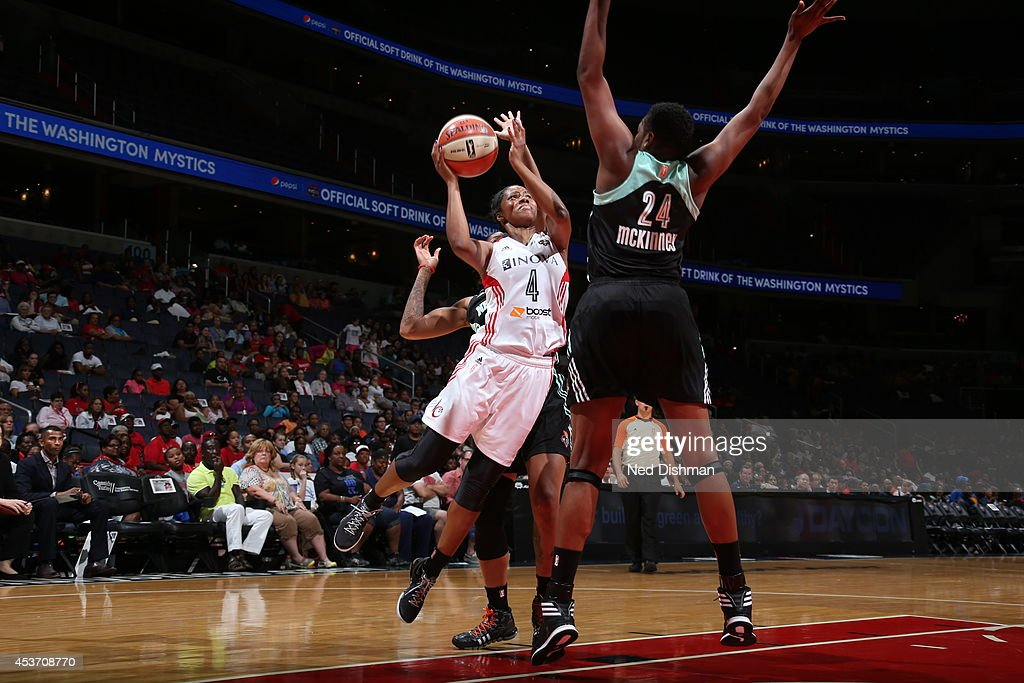 Taylor Hill #4 of the Washington Mystics shoots against Shanece McKinney #24 of the New York Liberty at the Verizon Center on August 16, 2014 in Washington, DC.