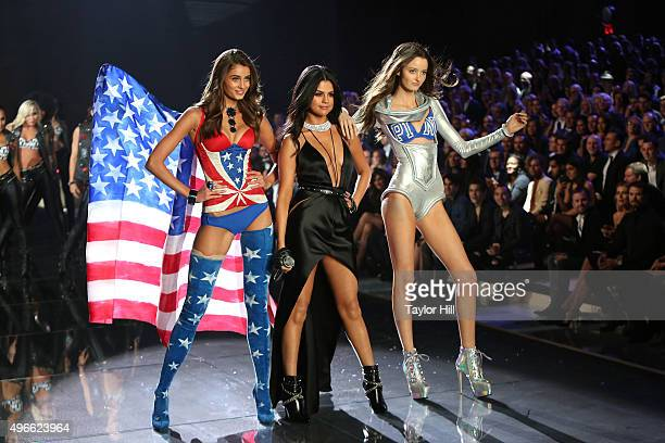 Taylor Hill Selena Gomez and Megan Puleri dance together during the 2015 Victoria's Secret Fashion Show at Lexington Avenue Armory on November 10...