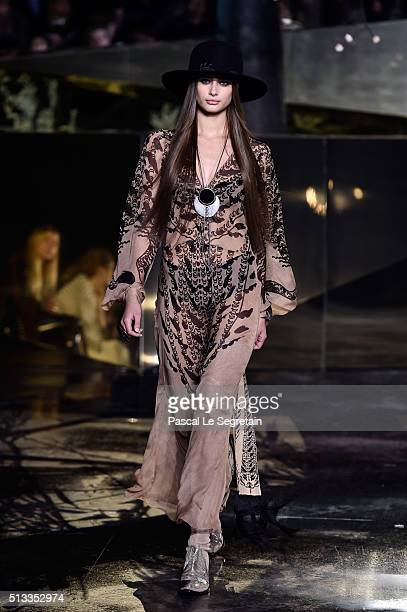 Taylor Hill walks the runway during the HM show as part of the Paris Fashion Week Womenswear Fall/Winter 2016/2017 on March 2 2016 in Paris France