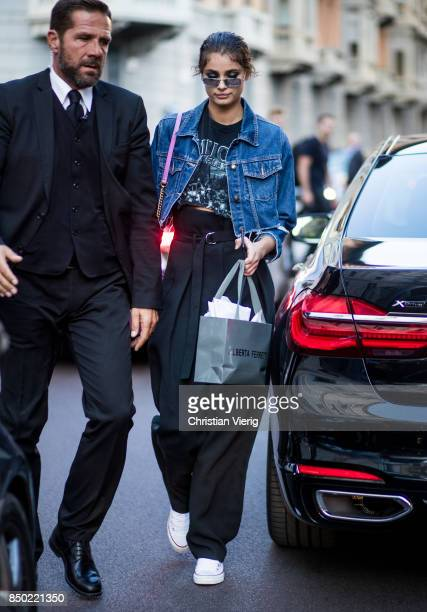 Taylor Hill wearing denim jacket pink Gucci bag high waisted pants is seen outside Alberta Ferretti during Milan Fashion Week Spring/Summer 2018 on...