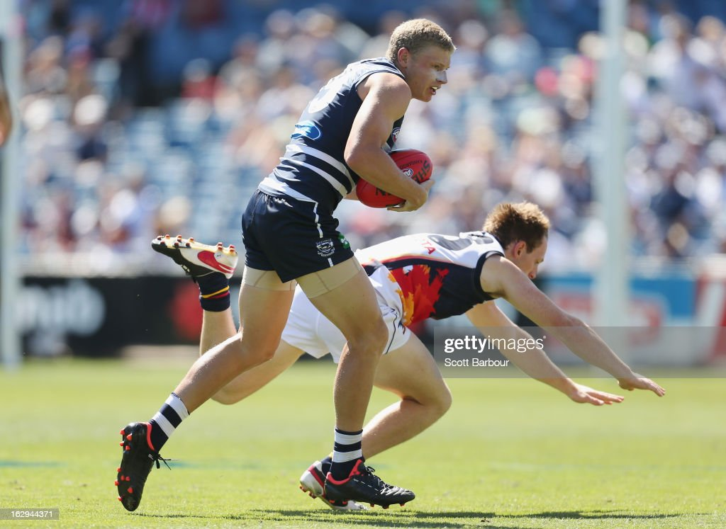 Taylor Hunt of the Cats pushes off a Crows defender during the round two AFL NAB Cup match between the Geelong Cats and the Adelaide Crows at Simonds Stadium on March 2, 2013 in Geelong, Australia.