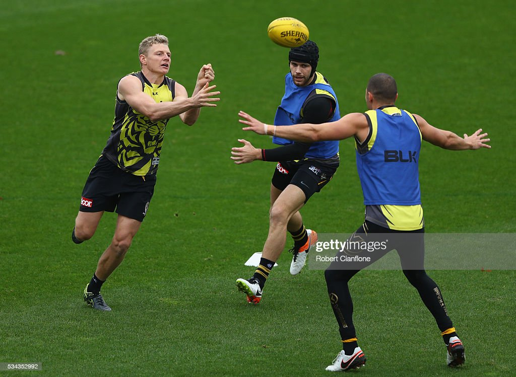 Taylor Hunt of the Tigers handballs during a Richmond Tigers AFL training session at ME Bank Centre on May 26, 2016 in Melbourne, Australia.