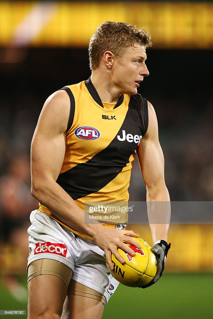 Taylor Hunt of the Tigers runs with the ball during the round 15 AFL match between the Port Adelaide Power and the Richmond Tigers at Adelaide Oval on July 1, 2016 in Adelaide, Australia.