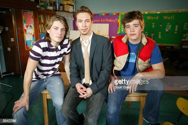 Taylor Isaac and Zac of the rock band Hanson pose for a photo after taking part in the VH1 Save The Music Master Class at PS 40 April 12 2004 in New...
