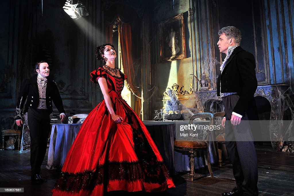 Taylor Jay-Davies as Young Pip, Grace Rowe as Estella and Paul Nivison as Adult Pippose during a photcall for 'Great Expectations' at Vaudeville Theatre on February 4, 2013 in London, England.