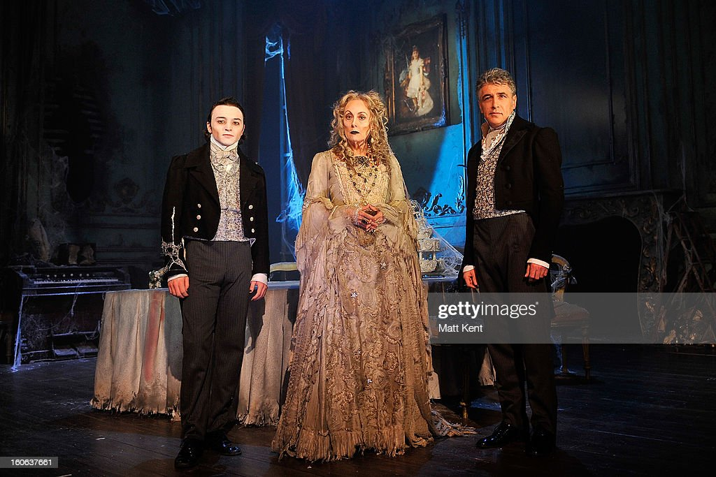 Taylor Jay-Davies as Young Pip, Paula Wilcox as Miss Havisham and Paul Nivison as Adult Pip pose during a photcall for 'Great Expectations' at Vaudeville Theatre on February 4, 2013 in London, England.