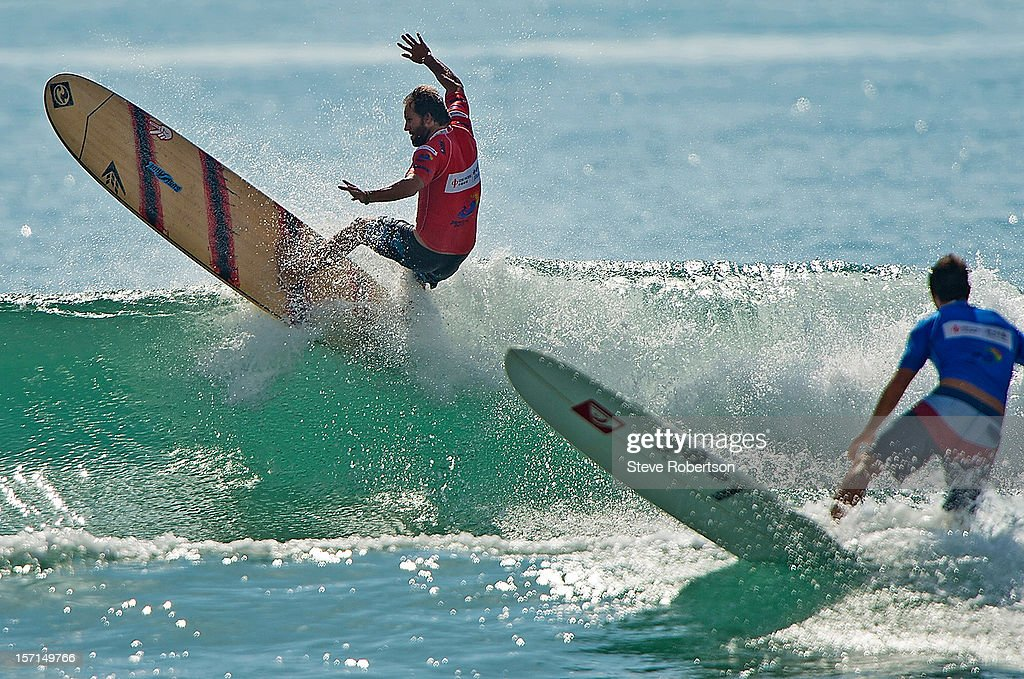Taylor Jensen of the USA competes in the 2012 CITIC PACIFIC ShenZhou Peninsula Pro on November 29, 2012 in Hainan Island, China. By winning the event Jensen also wins the 2012 ASP World Longboard Title.
