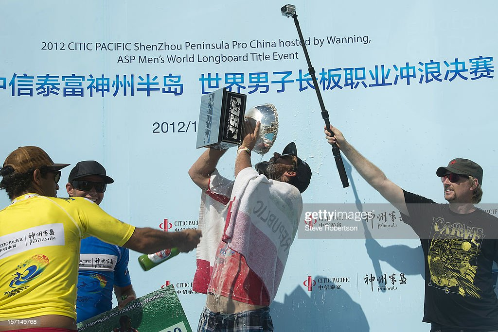 Taylor Jensen of the USA drinks from his trophy after winning the 2012 CITIC PACIFIC ShenZhou Peninsula Pro on November 29, 2012 in Hainan Island, China. By winning the event Jensen also wins the 2012 ASP World Longboard Title.