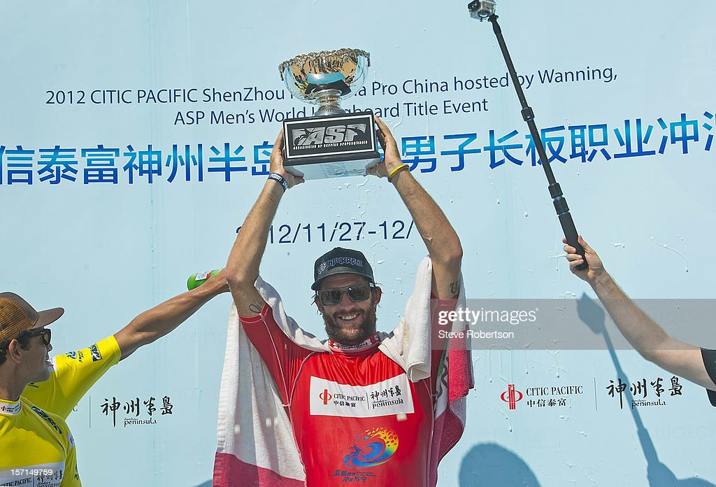 Taylor Jensen of the USA holds up his trophy after winning the 2012 CITIC PACIFIC ShenZhou Peninsula Pro on November 29, 2012 in Hainan Island, China. By winning the event Jensen also wins the 2012 ASP World Longboard Title.