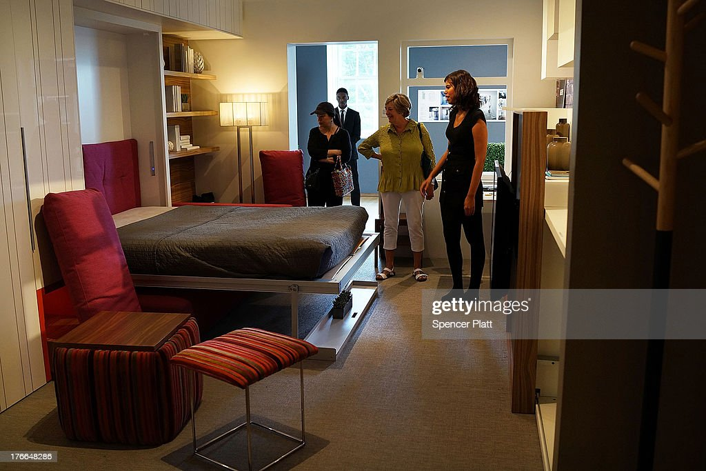 Taylor Jones, a museum intern, shows a 325-square-foot apartment at the Museum of the City of New York on August 16, 2013 in New York City. The exhibit, called 'Making Room', was inspired by a contest to design micro-apartments to help ease the affordable housing shortage. Two interns a night get an opportunity to stay in the apartment, designed by Resource Furniture and located inside the museum and then show it to visitors the next day. A new report by the office of Brooklyn Democrat and housing expert Brad Lander, a City Councilman, found that less than 2 percent of all apartments developed in the city since 2005 were deemed affordable housing. New York City Mayor Michael Bloomberg launched 'Inclusionary Housing Program' eight years ago in an attempt to get developers to to build larger and taller as long as they also set aside a portion of their apartments for low- to middle-income tenants.