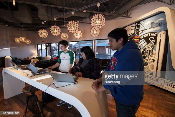 Taylor Kelly a Google Inc Fiber Space team member left discusses installation plans with customer Anna Rios center and her son Jacob Gomez in the...