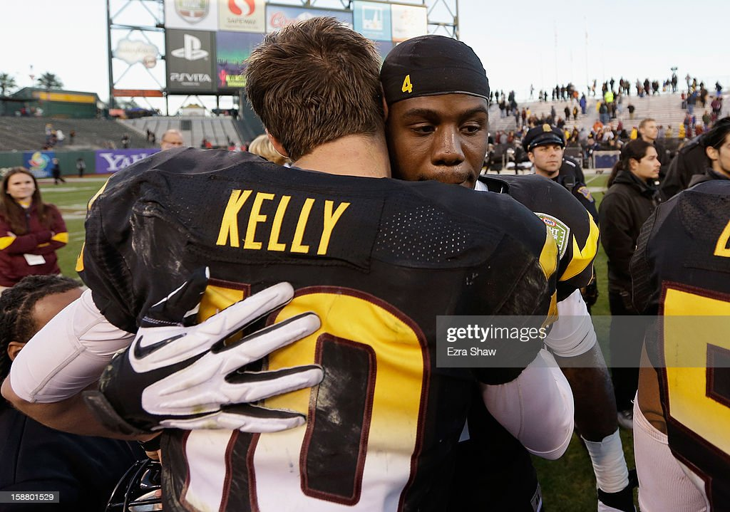 Taylor Kelly #10 congratulates Marion Grice #1 of the Arizona State Sun Devils after Grice was named offensive player of the game in their victory over the Navy Midshipmen in the Kraft Fight Hunger Bowl at AT&T Park on December 29, 2012 in San Francisco, California.