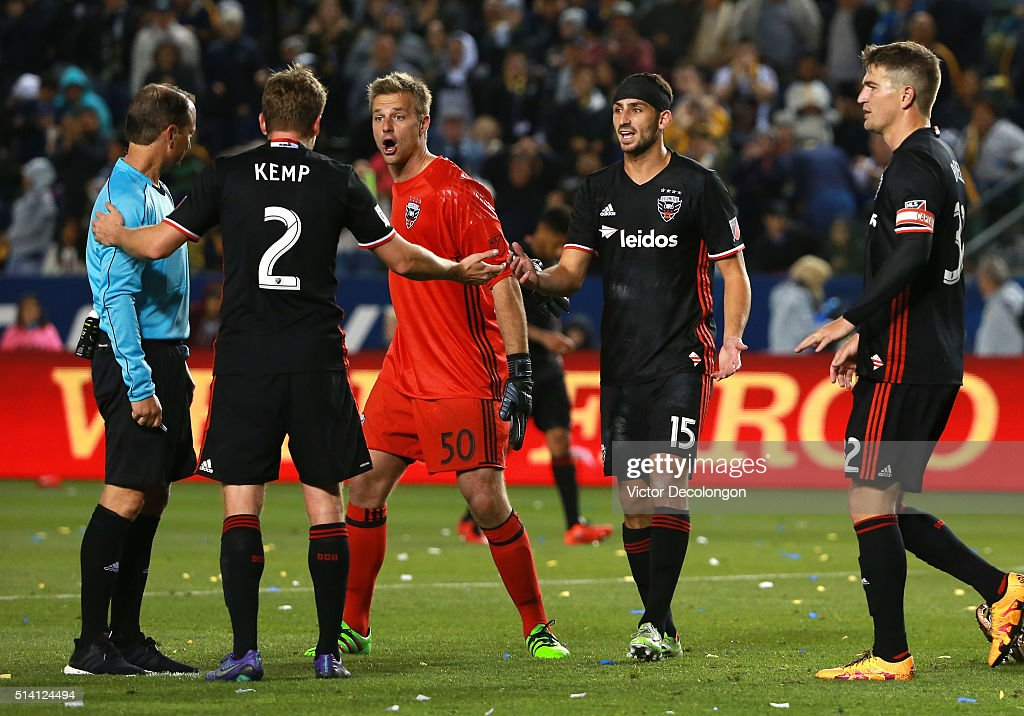 Taylor Kemp and teammate goalkeeper Andrew Dykstra of DC United plead their case with referee Kevin Stott as teammates Steve Birnbaum and Bobby...