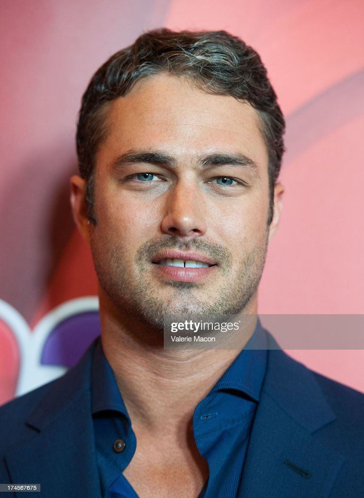 <a gi-track='captionPersonalityLinkClicked' href=/galleries/search?phrase=Taylor+Kinney&family=editorial&specificpeople=747018 ng-click='$event.stopPropagation()'>Taylor Kinney</a> arrives at the NBCUniversal's '2013 Summer TCA Tour' at The Beverly Hilton Hotel on July 27, 2013 in Beverly Hills, California.