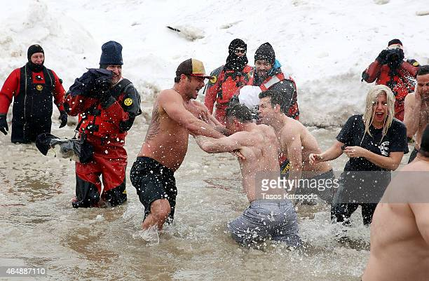 Taylor Kinney David Eigenberg Jon Seda and Lady Gaga participates in the Chicago Polar Plunge 2015 at North Avenue Beach on March 1 2015 in Chicago...
