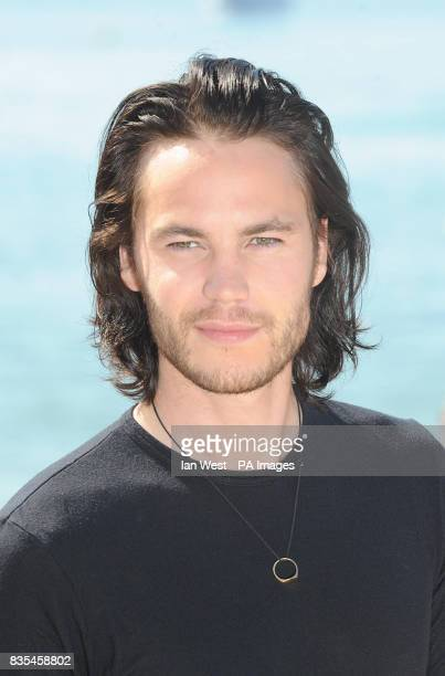 Taylor Kitsch during a photocall for the film The Bang Bang Club on the Gray D'Albion beach in Cannes France as part of the 62nd annual Cannes Film...