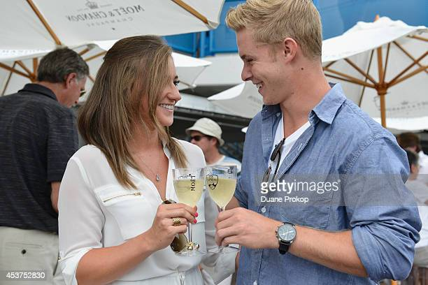 Taylor Laatsch and Tim Broderick toast with Moet Chandon the official Champagne of the Western Southern Open at Linder Family Tennis Center on August...