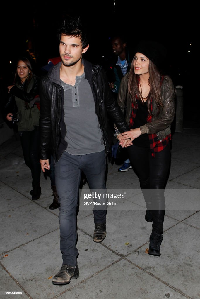 <a gi-track='captionPersonalityLinkClicked' href=/galleries/search?phrase=Taylor+Lautner&family=editorial&specificpeople=228959 ng-click='$event.stopPropagation()'>Taylor Lautner</a> and <a gi-track='captionPersonalityLinkClicked' href=/galleries/search?phrase=Marie+Avgeropoulos&family=editorial&specificpeople=6709928 ng-click='$event.stopPropagation()'>Marie Avgeropoulos</a> are seen arriving at Staples Center on December 09, 2013 in Los Angeles, California.